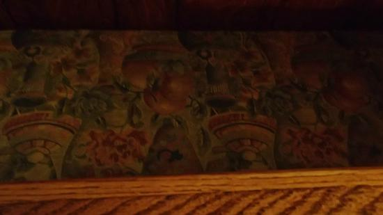 The Irish Lion Restaurant & Pub: embroidery on the benches in stall seating