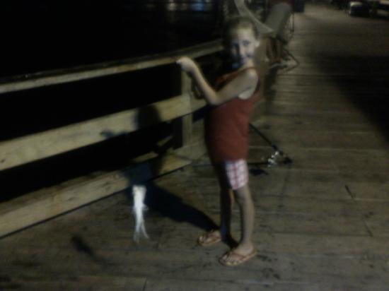 Blue Marlin Beach Lodging: Ivy age 7 caught a shark at Kure Beach Pier on our last night a the Blue Marlin!!!  Wonderful tr