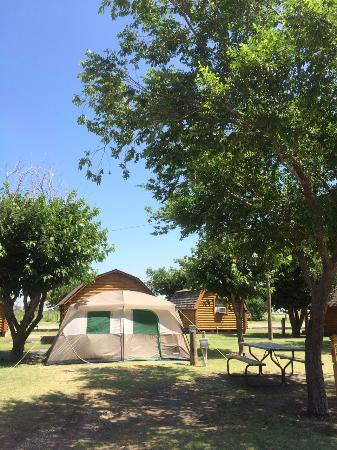 Amarillo KOA: Our tent site and you can see the cabins behind us