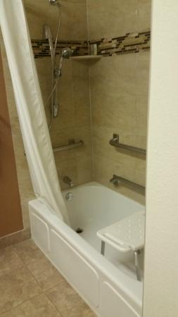 """Comfort Suites Golden West on Evergreen Parkway : """"Handicap"""" shower, person has to lift chair, which was wobbly, into shower"""
