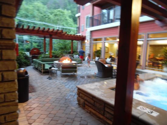 Outdoor spa and seating area picture of hilton garden for About you salon gatlinburg tn