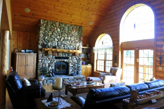 Tauschek's B & B Log Home : Living area with it's hand-crafted stone fireplace