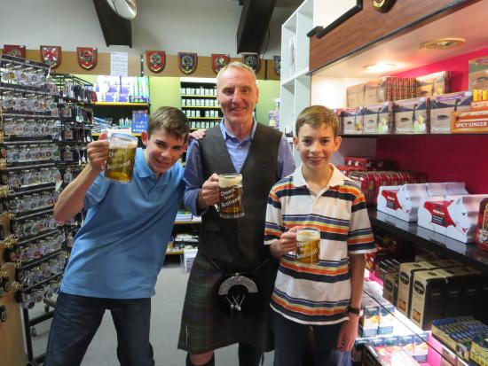 About Scotland: Ricki kept the boys entertained while helping my husband pick out a kilt in Inverness
