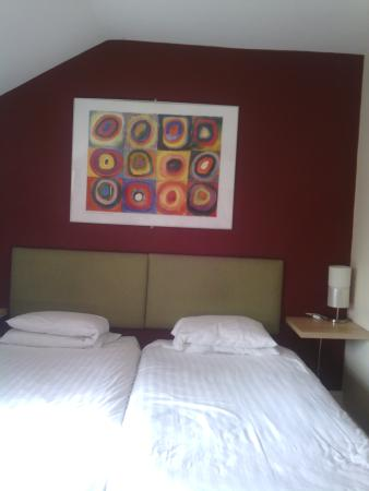 The Vaults: Beds and painting on the wall.