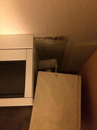 "Travelodge Hotel Saskatoon: Box beside the broken a/c Notice the top screw that ""secures"" it to the wall."