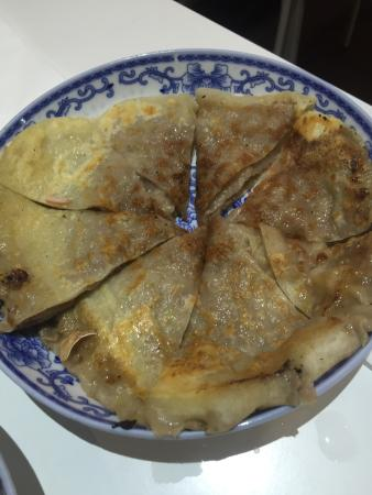 Nan S Dumpling Time Pan Fried Pork Buns Beef Pancake And Fried Chicken And Cabbage