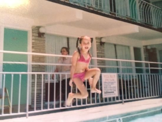 Panoramic Motel Apts : Kids having fun in the kiddie pool, Emma jumping in Big Pool n lounging in the bedroom at Motel