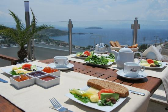table set for a traditional turkish breakfast picture of the terrace restaurant gumusluk. Black Bedroom Furniture Sets. Home Design Ideas