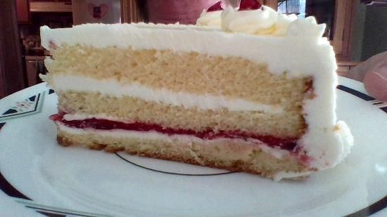 Sun Prairie, WI: small take home version of vanilla raspberry cake. When you get it by the slice it's TWICE as bi
