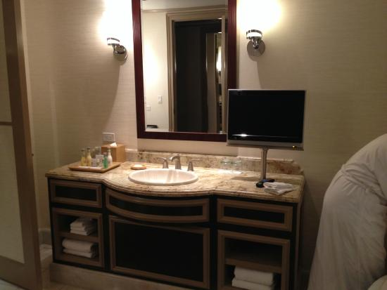 Bathroom Sinks Las Vegas both bathrooms have similar sinks/tvs. - picture of bellagio las
