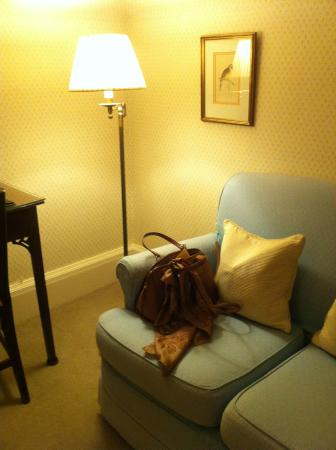 An English bedroom with classic handbag and scarf
