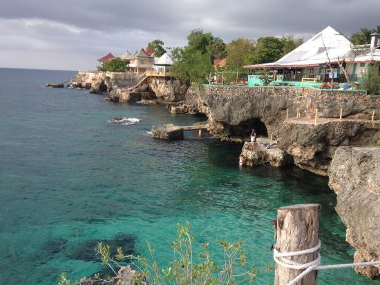 Xtabi Resort: View from the jerk stand next door, Three Dives!