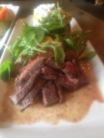 The Bavarian Inn Restaurant: Bison Steak with crushed potatoes and micro greens
