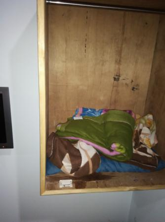 Shahana Guest House & Dormitory: old quilts kept in cupboard
