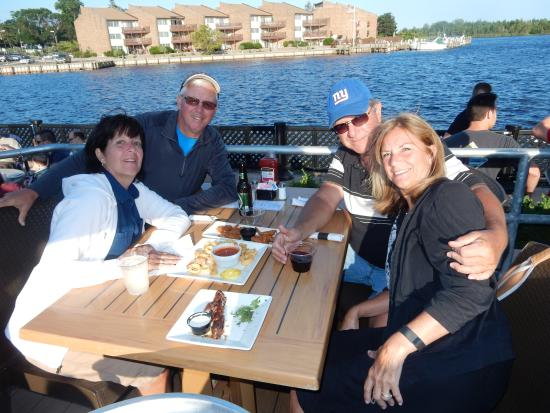 Four Happy Customers At Baker S Water Street Bar Grille Picture