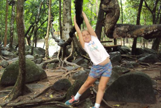Khao Chamao Khao Wong National Park: Granddaughtr Bonnie swinging from a fig tree root