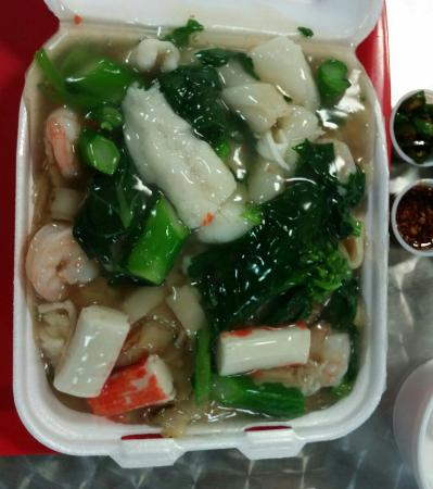 Harlam's Kitchen: Seafood with fried rice noodle ($7.00), well pan charred noodles with fresh seafood. Starchy gra