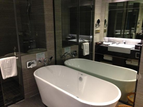 big bath room with bathtub and shower - picture of millennium hotel