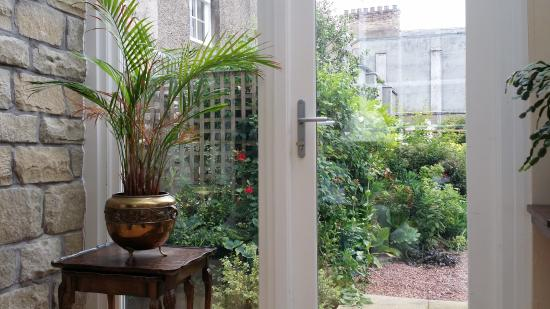 The Old Priory Bed and Breakfast: View from the conservatory, you can see the top of the Abbey