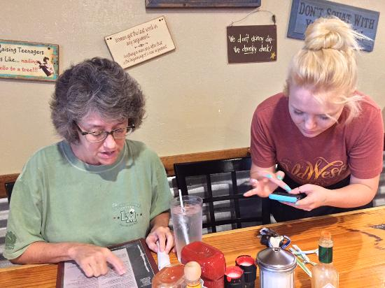 Old West Cafe: Allison takes order on an iPhone app