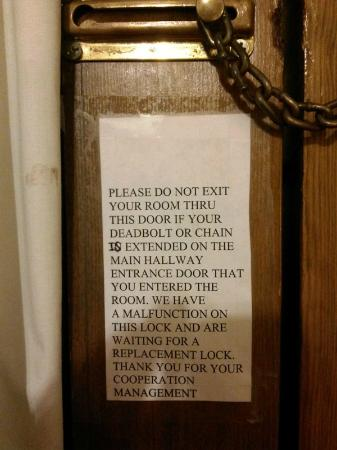 Days Inn Hutchinson: Sign on door that was screwed shut.