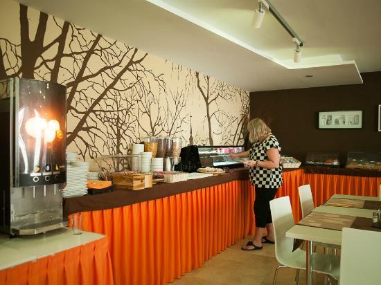 Benabola Hotel Suites My Mother Having Breakfast