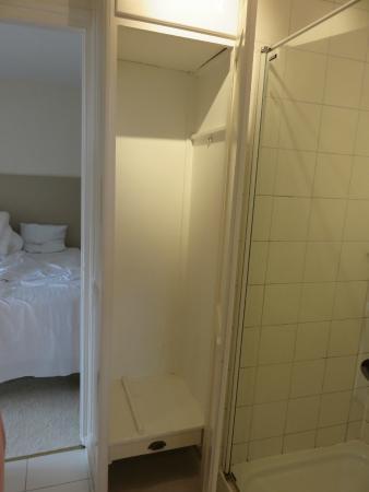 Villa Eden Palace Au Lac : Empty bathroom cupboard - no shelves or rail & hangers