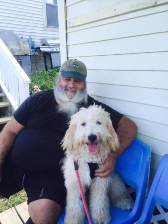 JJ's Snack Shack: John and our goldendoodle, Theo, chillin' after a delicious lunch of fried clams and lobster rol