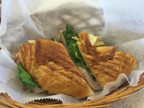 Gourmet Bakery Cafe: Turkey, brie and a touch of chipotle mayo.... OMG!