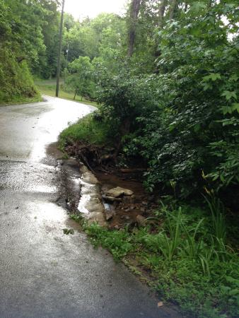 Berry Springs Lodge: When it rains heavy, this creek floods the road
