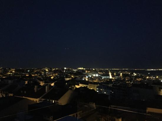 The House: Night view of Lisbon from rooftop