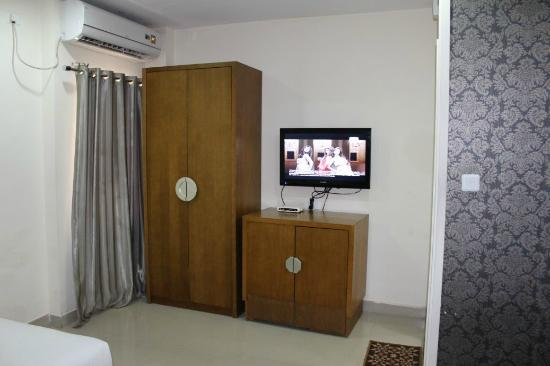 At Home Suites: Almirah and Fridge in cupboard