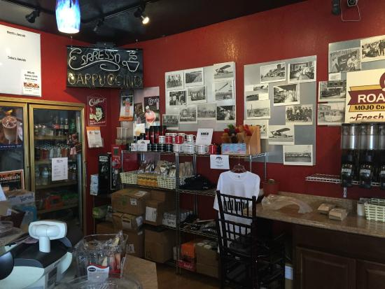 Mojo Cafe: varied wares for sale and vintage photos of the area
