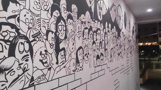 some humorous cartoons on the wall picture of city center haldia