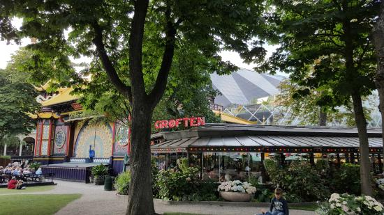 Tivoli Gardens Design Restaurant Nimb Hotel In The Background With The Mountain Behind