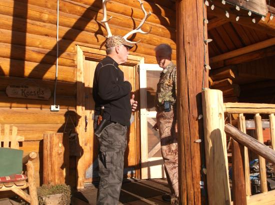 Silver Spur Outfitters: Front of Log Lodge with lounging deck