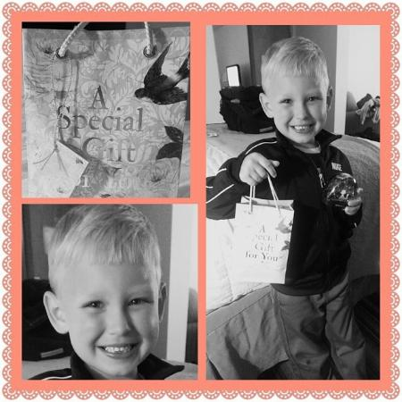 Quality Inn & Suites Rainwater Park: Grandson in our room holding up gift for his mommy.
