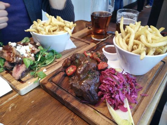 The Black Horse Pub and Eating House: To the right - Beef ribs with red cabbage (special menu).  On the left -  char grilled skirt ste