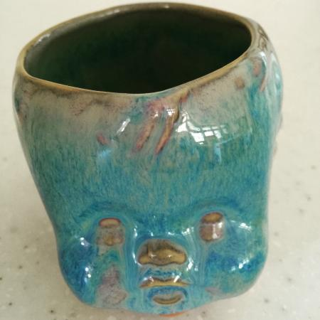 Scargo Stoneware Pottery & Art Gallery: Interesting little piece (planter? vase?) and a little creepy too! Love it!