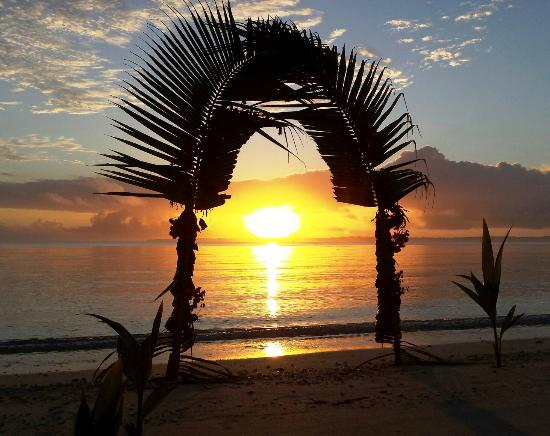 Akaiami Paradise: Sun setting over Aitutaki.