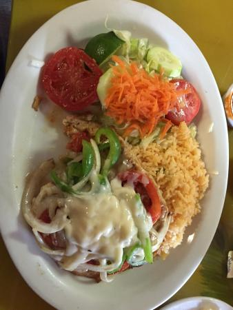 El Carbonero: Chicken Fundido, Bistek and Onions, and a papusa