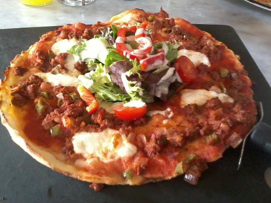 Pizza Express: SPICY BEEF AND SALAD IN MIDDLE.