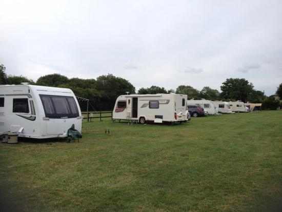 Camp site behind the Three Magpies. Plenty of space for vans and tents with or without electric