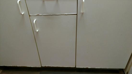 Extended Stay America - Louisville - Dutchman : all of the coating on the cabinets is coming off