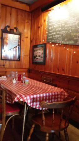 Rick's: Corner table with chalkboard specials