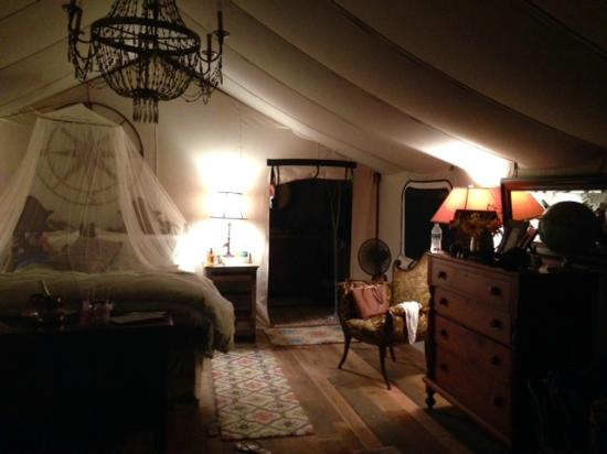 The Depot Lodge: The bed with mosquito net at night