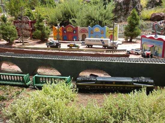 Medford Railroad Park: Town with electric train moving by in front.