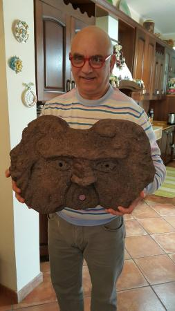 Villa Liliya: Owner with one of his carvings made from the volcanic Rock