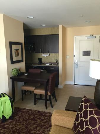Homewood Suites by Hilton Carle Place - Garden City: Standing in corner, bed on my left, couch in front of me on right)