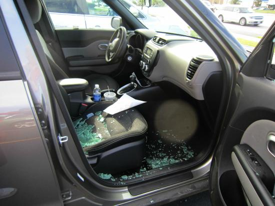 Rochester, Nowy Jork: This is what I came back to at the cemetery..window broken and my purse stolen.